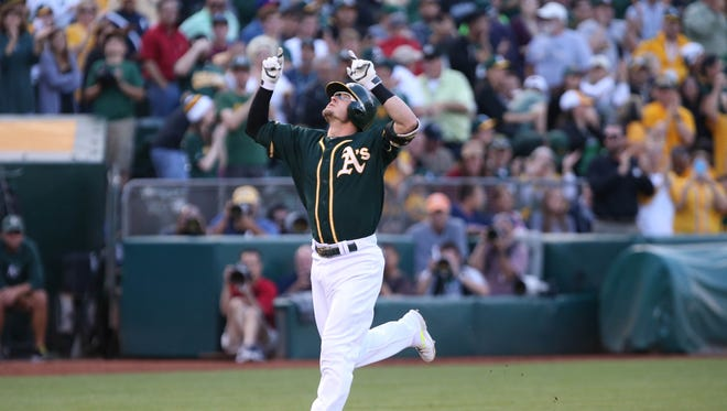 Oakland Athletics third baseman Josh Donaldson (20) celebrates as he runs the third baseline on a three run home run against the Boston Red Sox during the first inning at O.co Coliseum.