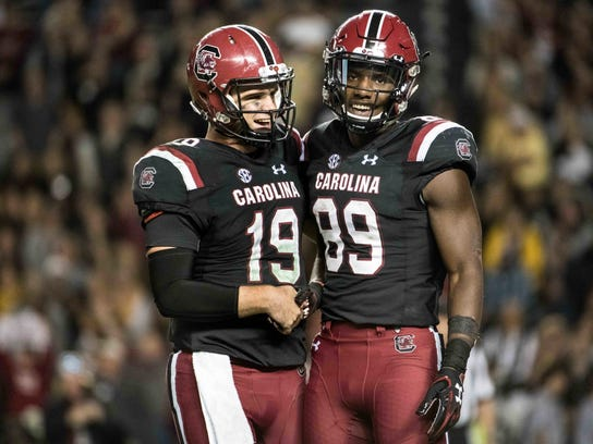 South Carolina quarterback Jake Bentley (19) and Bryan Edwards (89) celebrate after a touchdown during the second half of an NCAA college football game against Wofford on Saturday, Nov. 18, 2017 in Columbia, S.C. South Carolina defeated Wofford 31-10. (AP Photo/Sean Rayford)