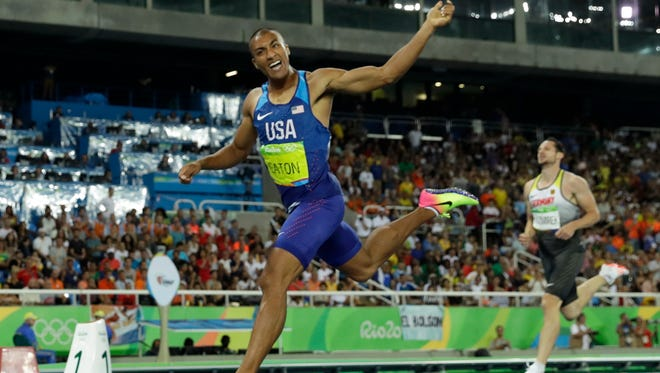 United States' Ashton Eaton crosses the line to win his 400-meter heat of the decathlon during the athletics competitions of the 2016 Summer Olympics at the Olympic stadium in Rio de Janeiro, Brazil, Wednesday, Aug. 17, 2016.
