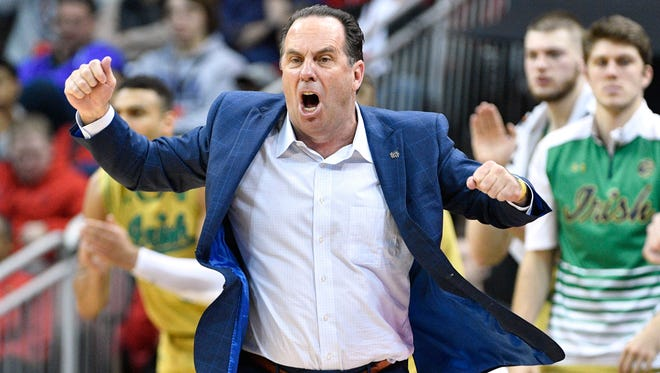 Mar 4, 2017; Louisville, KY, USA; Notre Dame Fighting Irish head coach Mike Brey reacts during the second half against the Louisville Cardinals at KFC Yum! Center. Louisville defeated Notre Dame 71-64.  Mandatory Credit: Jamie Rhodes-USA TODAY Sports