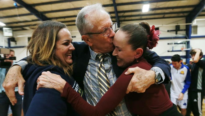 Cathedral coach Tony Harper celebrated his 1,000th victory with daughter Leslie and wife Andree Friday at the Cathedral gym.