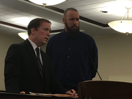 Buddy Struckman, at right, stands next to his attorney,