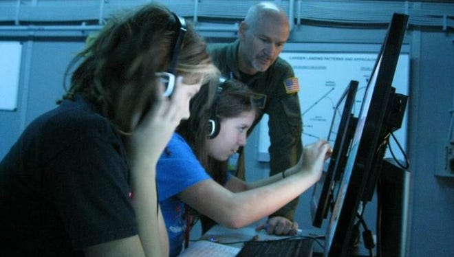 The National Flight Academy hosts its first cyber education and awareness showcase event.