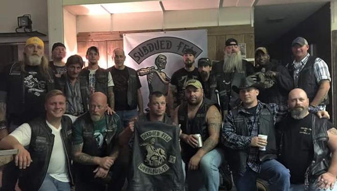 Members of the Subdued Few Motorcycle Club are pictured in the club's new home on Riverside Drive.