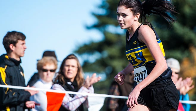 Breelle Wacker of Melstone sprints toward the finish line during the state cross country meet at Eagle Falls Golf Course on Saturday.