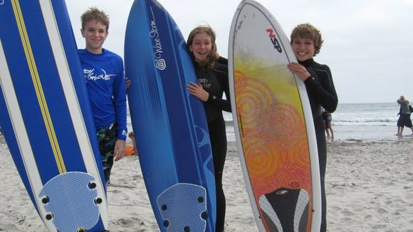 The kids on their surfboards didn't feel a thing when