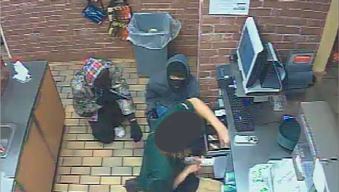 Caddo Sheriff deputies are searching for two men accused of robbing the Subway in Vivian Thursday.