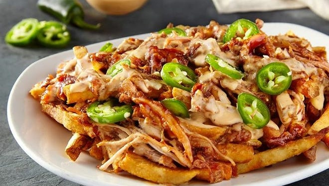 Pulled pork BBQ fries are among the specialty potato-based dishes served at French Fry Heaven.