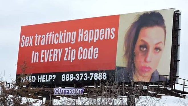 A billboard on I-75 in Genessee County shows an image of Jeannie Kennedy, a former prostitute who now works to help others recover from the impact of being sold for sex.