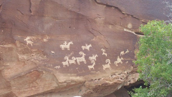 Petroglyphs on the way to Delicate Arch at Arches National Park in Utah. Climbing bolts damaged an ancient petroglyph site near Moab last week, just north of the park.