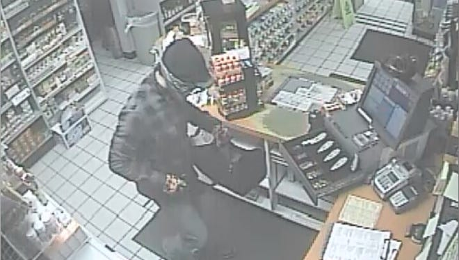 Police are searching for a man who robbed a Lexington gas station early Tuesday.