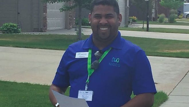 A Midco salesman sporting a shirt with company logo and an employee ID badge is pictured in this undated photo. The company's taken reports of solicitors pretending to represent the company going door-to-door in Sioux Falls and Bismarck. To verify if a seller is with the company, call 1-888-1300.