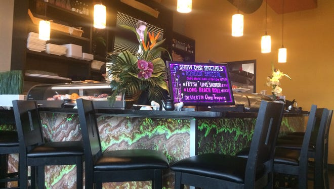 There is seating near the bar at Komoon Thai Sushi & Ceviche on Immokalee Road in North Naples.