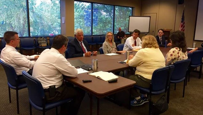 Williamson County Mayor Rogers Anderson and county Budget Director Nena Graham discuss a proposed sales tax increase with Brentwood City Commissioners and department heads.