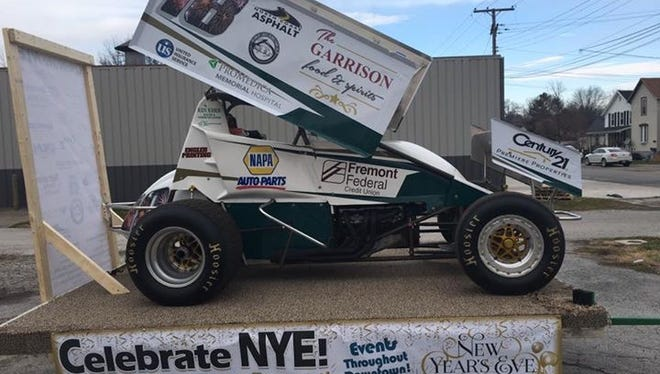 This 1,400-pound sprint car decorated with LED lights and decals of local sponsors will be lifted by a crane when the clock strikes midnight.