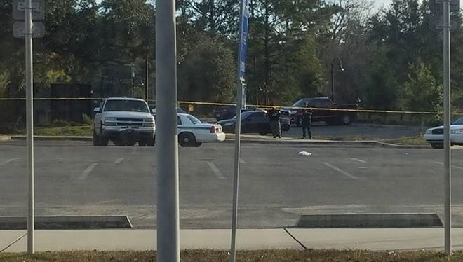 A Leon County Sheriff's deputy shot at a suspect near Cascades Park Sunday. The man was not hit but was later  taken to hospital after he crashed his vehicle following a chase. (Photo by Rachel Pienta)