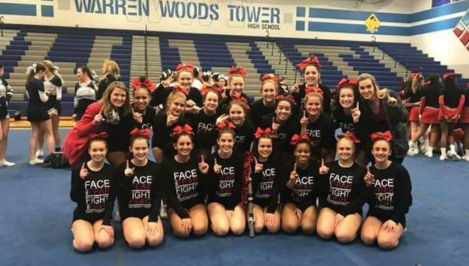 The Port Huron High School competitive cheer team celebrates its Macomb Area Conference Gold Division championship.