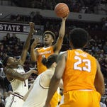 Tennessee guard Robert Hubbs III shoots over Mississippi State's Fred Thomas Saturday. MSU coach Ben Howland said the Bulldogs will switch to a man defense after losing 80-75.