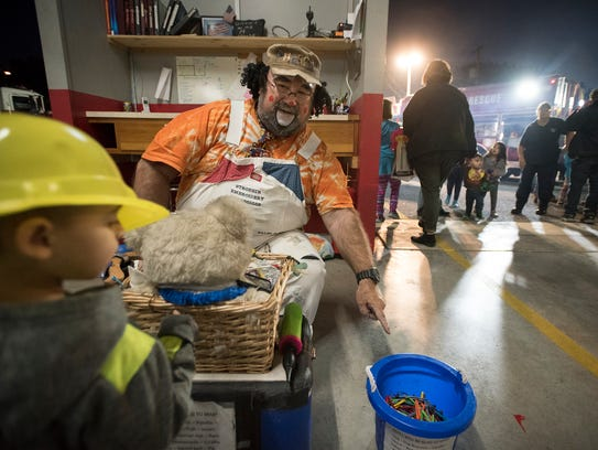 Huffy the Clown builds balloon animals for kids attending the Neversink Fire Company Open House Monday evening, Oct. 16 in Lebanon.