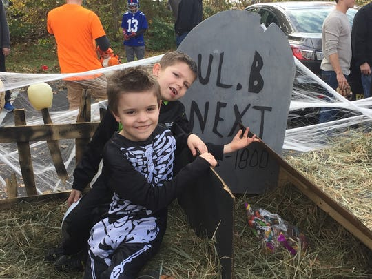 Austin Hare, left, age 8 and Logan Rogers, 8, check out a hidden compartment inside the Pentair float at the Grace Smith House Halloween parade in the City of Poughkeepsie Sunday, Oct. 30, 2016.