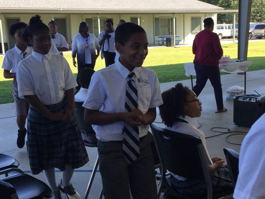 The Church Academy-Lafayette students attend a ribbon