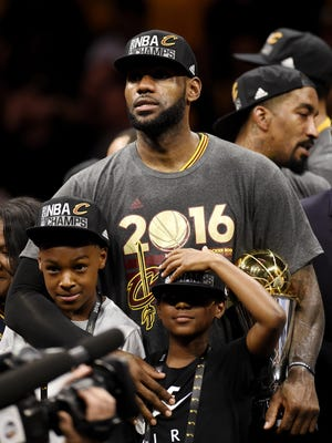Cavaliers forward LeBron James with the Bill Russell Finals MVP trophy after beating the Golden State Warriors in game seven of the NBA Finals at Oracle Arena.