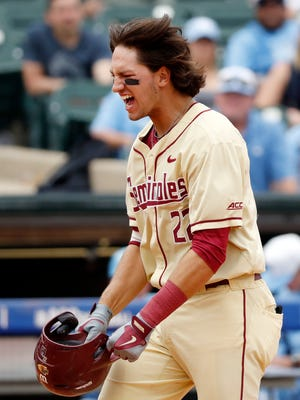 Florida State infielder Drew Mendoza (22) reacts after hitting a home run in the NCAA college Atlantic Coast Conference baseball tournament championship game in Louisville, Ky., Sunday, May 28, 2017. (Wade Payne/theACC.com via AP)