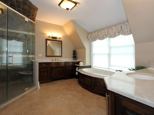 The master bath is modern and elegant.