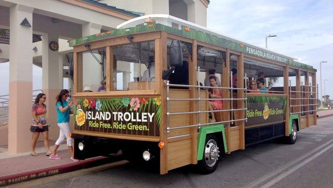 In this September file photo, passengers board a Santa Rosa Island Authority trolley.