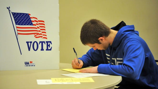 First-time voter Jared Wentz casts a provisional ballot in the primary election in March 2012 in Lancaster. Those who are not registered will be asked to cast provisional ballots in November.