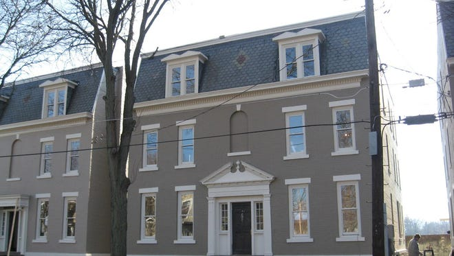 Row houses on West Water Street are part of the Near Westside Neighborhood Association's Homes for the Holiday tour.