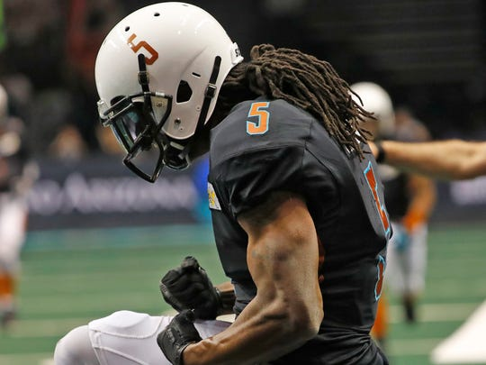 Rattlers Anthony Amos (5) celebrates a touchdown catch against the Titans during the first half at Talking Stick Resort Arena on March 31, 2018 in Phoenix, Ariz.