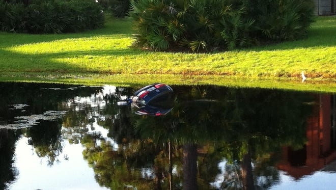 A car went into a pond near an apartment complex off Apollo Road Wednesday morning.