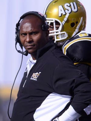 Alabama State Head Coach Reggie Barlow checks the scoreboard during their game with Alabama A&M in the 72nd State Farm Magic City Classic at Legion Field on Saturday, Oct. 26, 2013, in Birmingham, Ala.