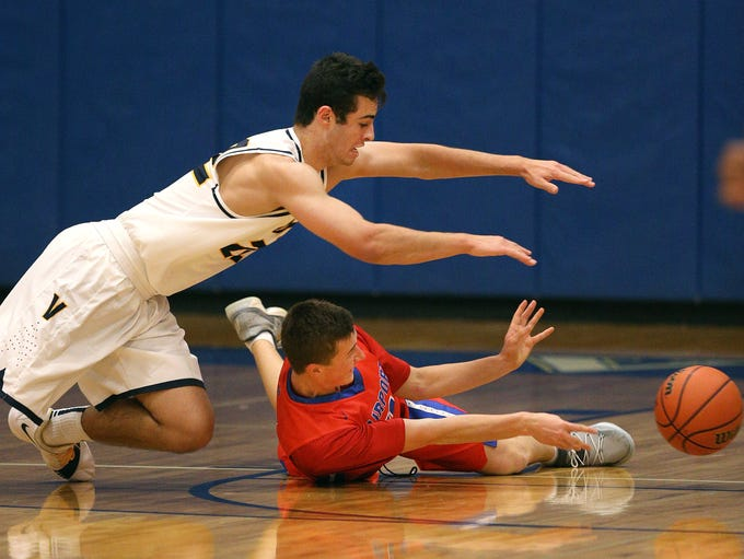 Fairport's Andrew Bartlett makes a pass from the floor