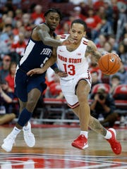 Ohio State's C.J. Walker, right, dribbles up court as Penn State's Jamari Wheeler defends during the second half of an NCAA college basketball game Saturday, Dec. 7, 2019, in Columbus, Ohio. Ohio State beat Penn State 104-74. (AP Photo/Jay LaPrete)