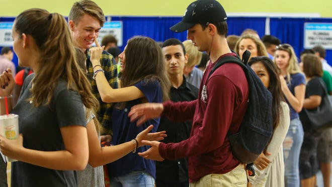 Students line up to speak to a representative from Florida Central University at College Night on Monday, Sept.19, 2016. Florida schools drew the most attention from prospective students.