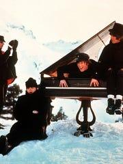 The Beatles' Ringo Starr, left, Paul McCartney, John