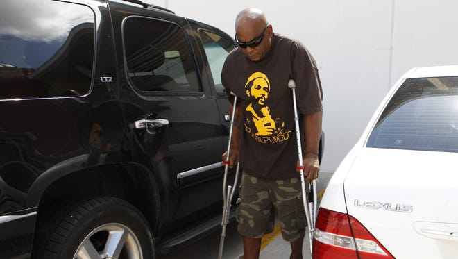 Photo taken July 8, 2013 : Mobility was a major issue for former Cincinnati Bengals player and Cincinnati City Councilman Reggie Williams. Now he can walk with minimal pain.