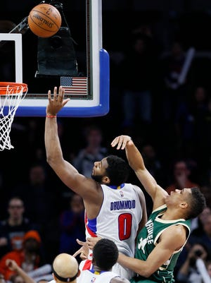 Detroit Pistons' Andre Drummond (0), defended by Milwaukee Bucks' Giannis Antetokounmpo (34), puts back a missed shot by teammate Kentavious Caldwell-Pope to defeat the Bucks 92-91 during the fourth quarter of an NBA basketball game, Monday, March 21, 2016, in Auburn Hills, Mich.