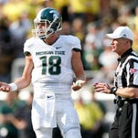 Michigan State quarterback Connor Cook questions a call by an official during Saturday's 46-27 loss to the Oregon Ducks.