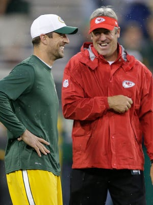 Green Bay Packers' Aaron Rodgers shares a laugh with former Kansas City Chiefs Offensive Coordinator Doug Pederson prior to the start of the game. Pederson is a former Green Bay Packers quarterback, and is reportedly the new head coach of the Philadelphia Eagles.