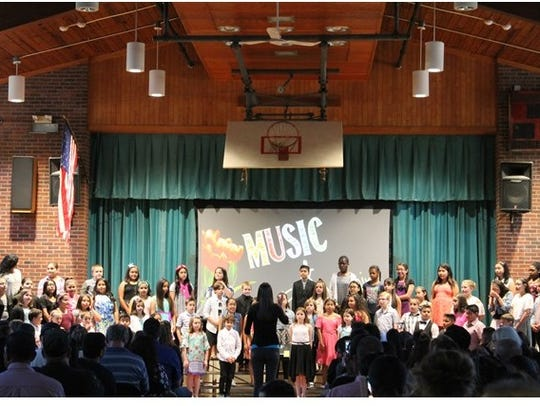 The choir performing at Faber School in Dunellen.