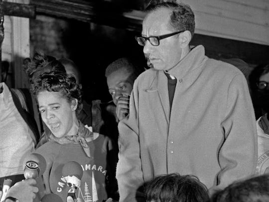 Ald. Vel Phillips and Father James E. Groppi answered questions from newsmen on the porch of the NAACP youth council Freedom House after police arrested many people at a rally for fair housing the group was holding on Aug. 31, 1967.