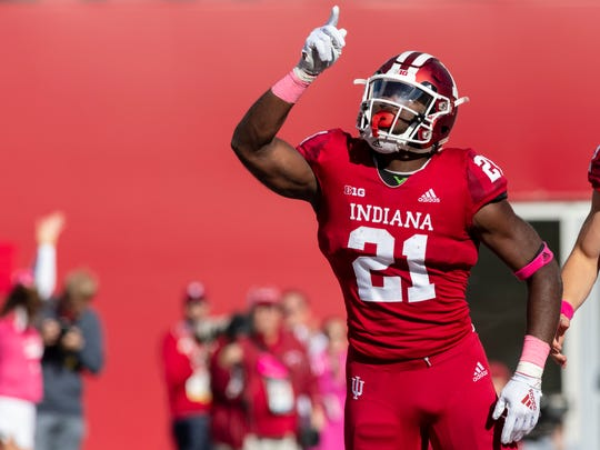 FILE - In this Oct. 20, 2018, file photo, Indiana running back Stevie Scott gestures after scoring a touchdown during the first half of the team's NCAA college football game against Penn State in Bloomington, Ind. Mike Hart ran for a school-record 5,040 yards at Michigan from 2004 to 2007, but he won't be wearing maize and blue on Saturday. Hart is Indiana's running backs coach and among the nominees for the Broyles Award, which honors college football's top assistant. He has coached Scott, who is second among the nation's freshmen with 894 yards rushing. (AP Photo/Doug McSchooler, File)
