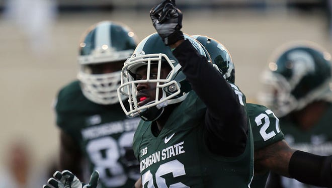 Michigan State safety RJ Williamson celebrates his interception return for a touchdown during Sunday's win over U-M.