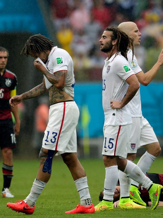 United States' Jermaine Jones (13), Kyle Beckerman (15) and Michael Bradley, far right, walk over the pitch during the group G World Cup soccer match between the USA and Germany at the Arena Pernambuco in Recife, Brazil, Thursday, June 26, 2014. (AP Photo/Petr David Josek)