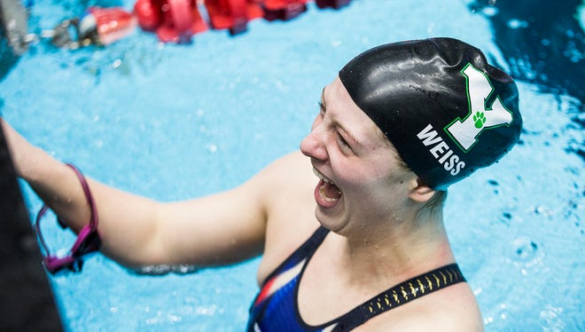 Yorktown's Emily Weiss is congratulated after winning the 100 breaststroke and breaking the event's national speed record at the IU Natatorium Saturday, Feb. 10, 2018.