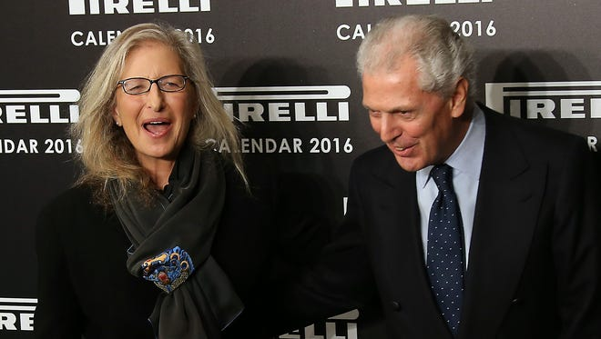 Photographer Annie Leibovitz and chairman and chief executive officer of Pirelli, Marco Tronchetti, pose for photographers upon arrival for the Pirelli Calendar 2016 launch at the Grosvenor Hotel Ballroom in London, Monday, Nov. 30, 2015.