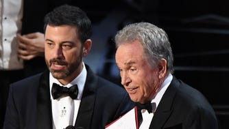 Warren Beatty explains to the audience how he had the wrong award card for best picture during the 89th Academy Awards at Dolby Theatre.
